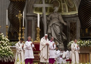 epa03645767 Pope Francis (C) leads the Easter Vigil on Holy Saturday at the St Peter's Basilica, Vatican City, 30 March 2013. Pope Francis, on 30 March 2013, stressed the message of hope associated with Jesus Christ's resurrection, hours before leading the Vatican's traditional Easter Vigil in Saint Peter's Basilica. EPA/CLAUDIO PERI